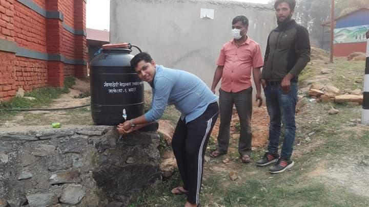 a man practising hand washing in lockdown